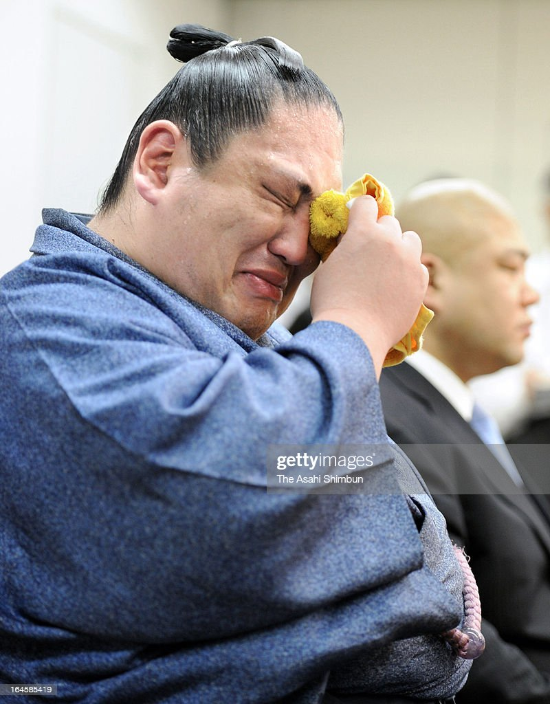 Former Ozeki (second highest rank in sumo) Miyabiyama wipes the tears during a press conference on his retirement at Osaka Prefecture Gymnasium on March 24, 2013 in Osaka, Japan.