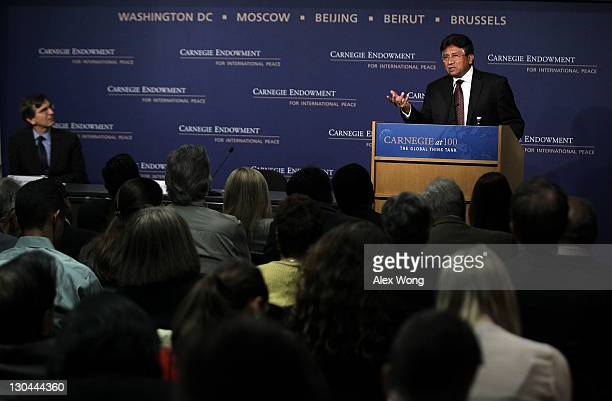 Former Pakistan President Pervez Musharraf speaks as George Perkovich vice president for studies and director of the Nuclear Policy Program at the...