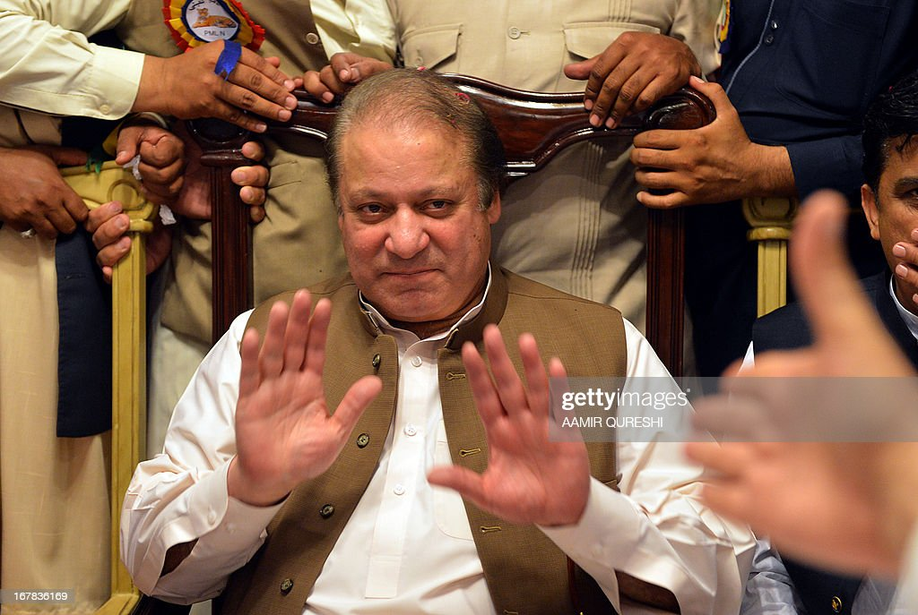 Former Pakistani premier Nawaz Sharif gestures as attends a meeting of traders during election campaign in Islamabad on May 1, 2013. An election candidate escaped unharmed on May 1 in a suicide bombing in southern Pakistan which left two people wounded, police said, after the latest in a wave of attacks to hit the campaign. Violence has spiked in the nuclear-armed country ahead of national elections on May 11, with at least 61 people killed in attacks on politicians and political parties since April 11, 2013.