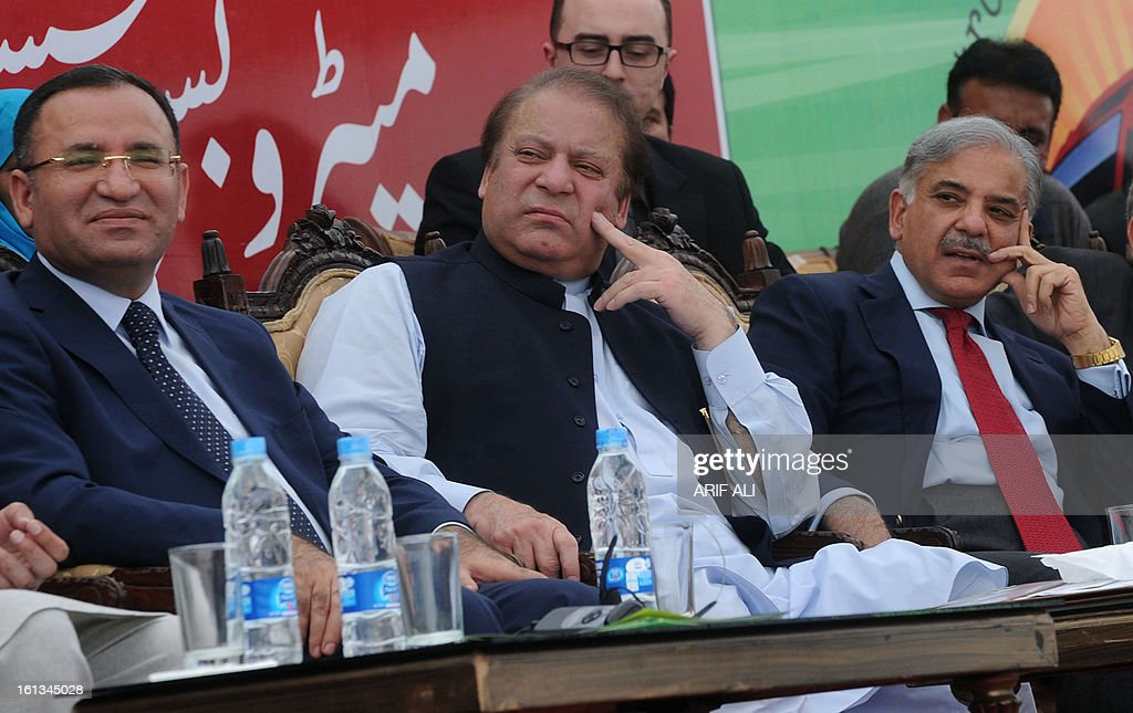 Former Pakistani premier Nawaz Sharif (C), his brother and Punjab province Chief Minister Shahbaz Sharif (R) sit with Turkish deputy prime minister Bekir Bozdag during the launch of the Metro Bus system in Lahore on February 10, 2013. Authorities in Pakistan on Sunday launched a 'Metro Bus' system in the second largest city, Lahore, the restive country's first major urban public transport scheme. AFP PHOTO/Arif ALI