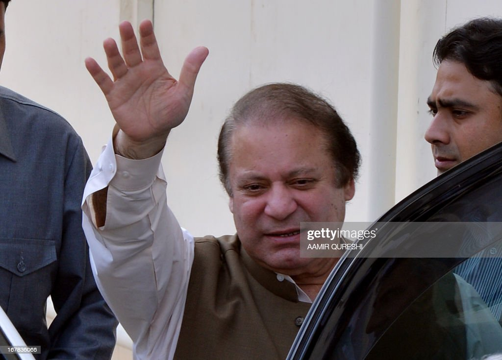 Former Pakistani premier Nawaz Sharif waves to supporters as he leaves after attending a meeting with traders during election campaign in Islamabad on May 1, 2013. An election candidate escaped unharmed on May 1 in a suicide bombing in southern Pakistan which left two people wounded, police said, after the latest in a wave of attacks to hit the campaign. Violence has spiked in the nuclear-armed country ahead of national elections on May 11, with at least 61 people killed in attacks on politicians and political parties since April 11, 2013.
