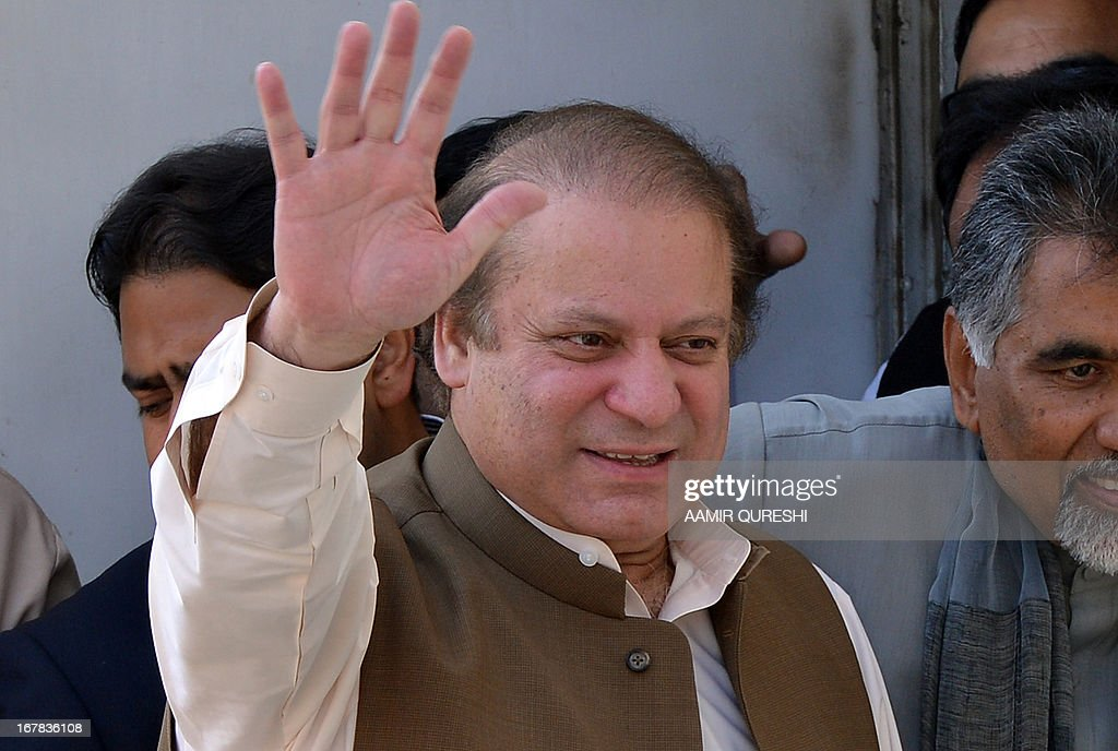 Former Pakistani premier Nawaz Sharif waves to supporters as he leaves after attending a meeting with traders during election campaign in Islamabad on May 1, 2013. An election candidate escaped unharmed on May 1 in a suicide bombing in southern Pakistan which left two people wounded, police said, after the latest in a wave of attacks to hit the campaign. Violence has spiked in the nuclear-armed country ahead of national elections on May 11, with at least 61 people killed in attacks on politicians and political parties since April 11, 2013. AFP PHOTO / AAMIR QURESHI