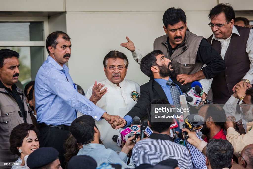Former Pakistani president, <a gi-track='captionPersonalityLinkClicked' href=/galleries/search?phrase=Pervez+Musharraf&family=editorial&specificpeople=121550 ng-click='$event.stopPropagation()'>Pervez Musharraf</a> addresses a crowd supporters after landing on Pakistani soil at Jinnah International airport on March 24, 2013 in Karachi, Pakistan. The former Pakistani president and military ruler returned to Pakistan after 4 years of self-imposed exile to participate in historic elections in May. Mr Musharraf has been granted protective bail in several cases, including conspiracy to murder which has paved his way allowing for his return amidst threats from the Taliban.