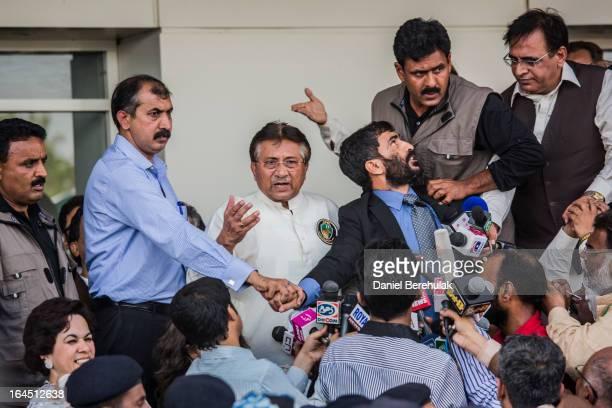 Former Pakistani president Pervez Musharraf addresses a crowd supporters after landing on Pakistani soil at Jinnah International airport on March 24...