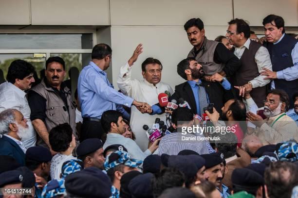 Former Pakistani president Pervez Musharraf addresses a group of a few hundred supporters after landing on Pakistani soil at Jinnah International...