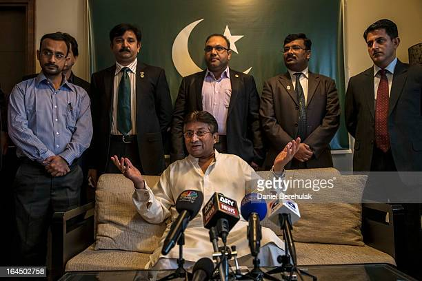 Former Pakistani president Pervez Musharraf briefs media and supporters during a press conference ahead of his return at the Dubai APML party...