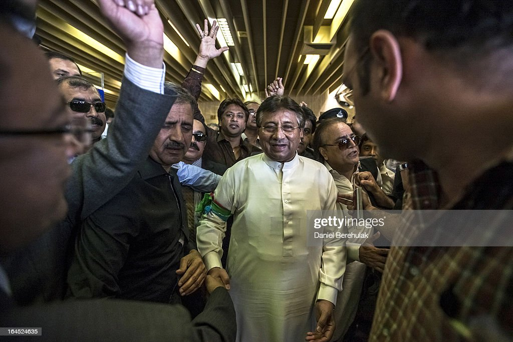 Former Pakistani president Pervez Musharraf is greeted by supporters after landing on Pakistani soil at Jinnah International airport on March 24, 2013 in Karachi, Pakistan. The former Pakistani president and military ruler returned to Pakistan after 4 years of self-imposed exile to participate in historic elections in May. Mr Musharraf has been granted protective bail in several cases, including conspiracy to murder which has paved his way allowing for his return amidst threats from the Taliban.