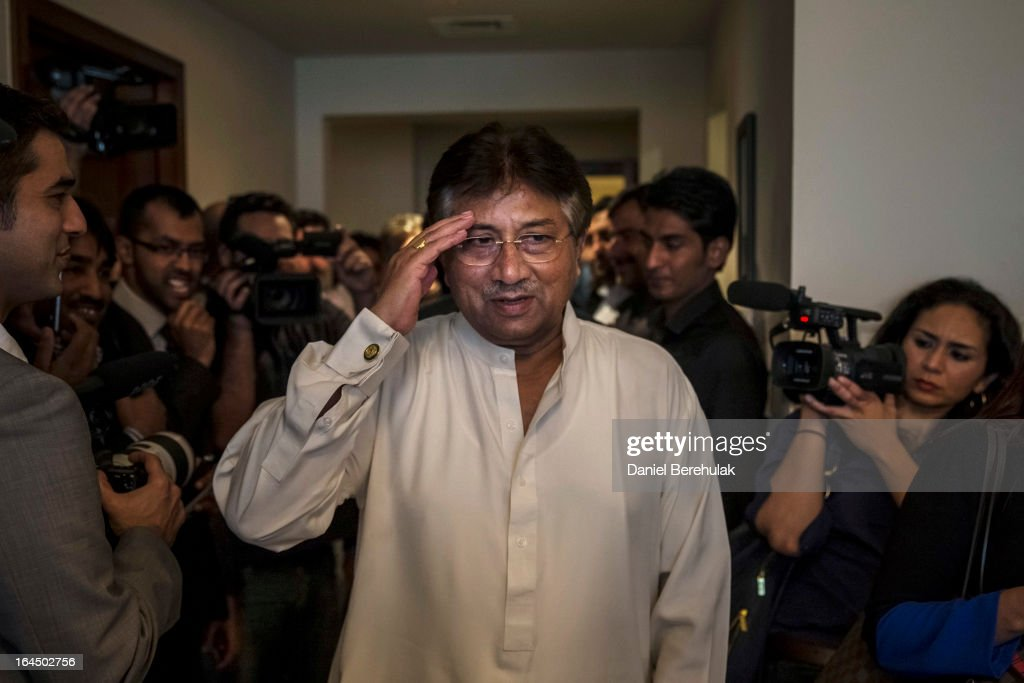 Former Pakistani president, <a gi-track='captionPersonalityLinkClicked' href=/galleries/search?phrase=Pervez+Musharraf&family=editorial&specificpeople=121550 ng-click='$event.stopPropagation()'>Pervez Musharraf</a> salutes as he arrives to brief media and supporters during a press conference ahead of his return, at the Dubai APML party headquarters on March 24, 2013 in Dubai United Arab Emirates. The former Pakistani president and military ruler is returning to Pakistan after 4 years of self-imposed exile to participate in historic elections in May. Mr Musharraf has been granted protective bail in several cases, including conspiracy to murder which has paved his way allowing for his return.
