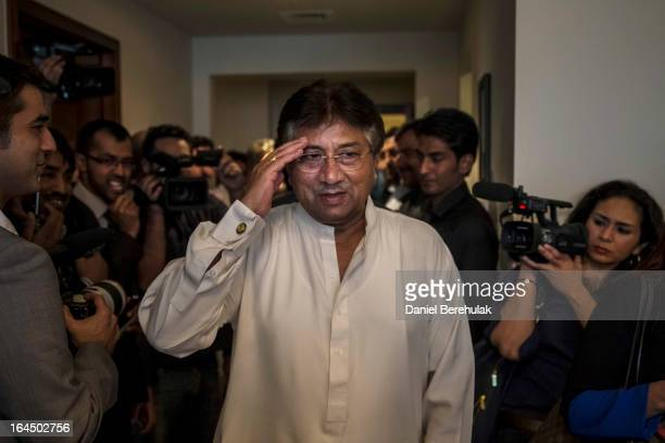 Former Pakistani president Pervez Musharraf salutes as he arrives to brief media and supporters during a press conference ahead of his return at the...