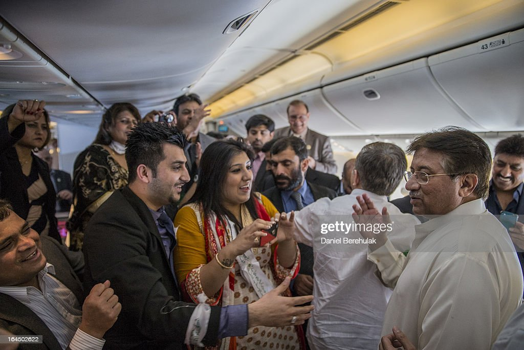 Former Pakistani president, <a gi-track='captionPersonalityLinkClicked' href=/galleries/search?phrase=Pervez+Musharraf&family=editorial&specificpeople=121550 ng-click='$event.stopPropagation()'>Pervez Musharraf</a> walks through the cabin as he greets his All Pakistan Muslim League (APML) party supporters on his Emirates flight 606 from Dubai to Karachi on March 24, 2013 mid flight between Dubai and Karachi, Pakistan. The former Pakistani president and military ruler is returning to Pakistan after 4 years of self-imposed exile to participate in historic elections in May. Mr Musharraf has been granted protective bail in several cases, including conspiracy to murder which has paved his way allowing for his return.