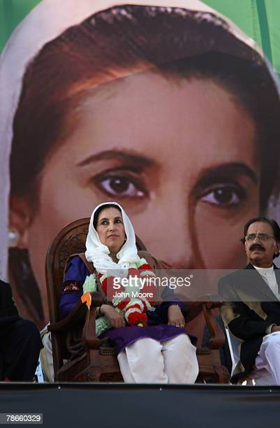 Former Pakistani Prime Minister Benazir Bhutto sits on stage at a campaign rally minutes before she was assassinated in an attack December 27 2007 in...