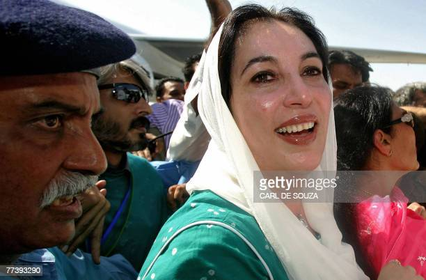 Former Pakistani Prime Minister Benazir Bhutto smiles as she lands at Karachi international airport after leaving Dubai 18 October 2007 Bhutto is...