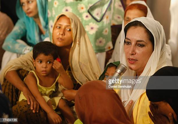 Former Pakistani prime minister Benazir Bhutto talks to friends and family of bomb victims during a prayer service in their memory at her house on...