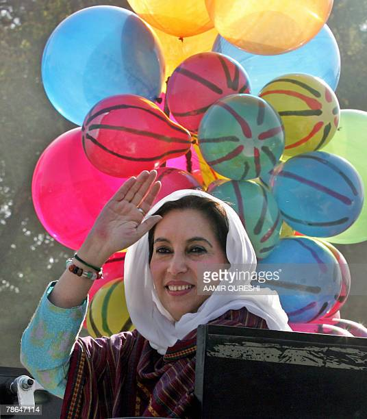 Former Pakistani prime minister Benazir Bhutto waves to her supporters during an election campaign rally in Hassan Abdal 35 kilometers west of...