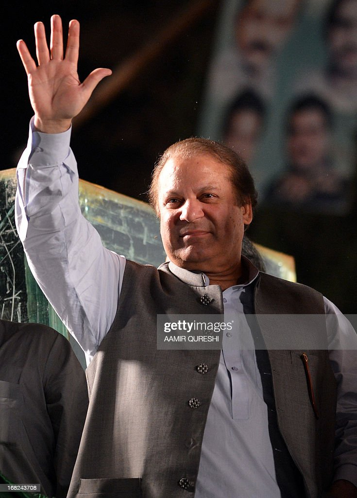 Former Pakistani Prime Minister Nawaz Sharif waves to supporters during an election campaign meeting in Rawalpindi on May 7, 2013. The election will mark a democratic milestone in a country ruled for half its history by the military. It will be the first time that a civilian government has served a full term and handed over to another at the ballot box. AFP PHOTO / AAMIR QURESHI