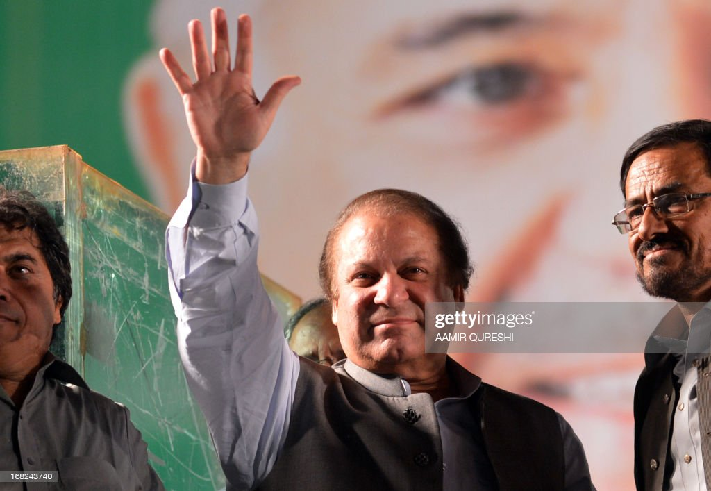 Former Pakistani Prime Minister Nawaz Sharif waves to supporters during an election campaign meeting in Rawalpindi on May 7, 2013. The election will mark a democratic milestone in a country ruled for half its history by the military. It will be the first time that a civilian government has served a full term and handed over to another at the ballot box.