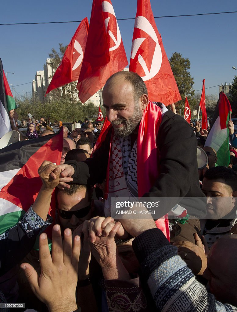 Former Palestinian prisoner Jihad Abedi (C) is carried on the shoulders of friends and relatives as he arrives in neighborhood of Jerusalem following his release on January 20, 2013, from an Israeli jail after serving 25 years.
