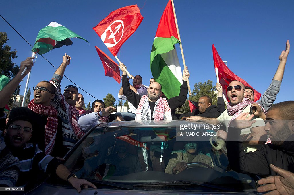 Former Palestinian prisoner Jihad Abedi (C) is greeted as he is driven through a neighborhood of Jerusalem following his release from an Israeli jail after serving 25 years, on January 20, 2013.