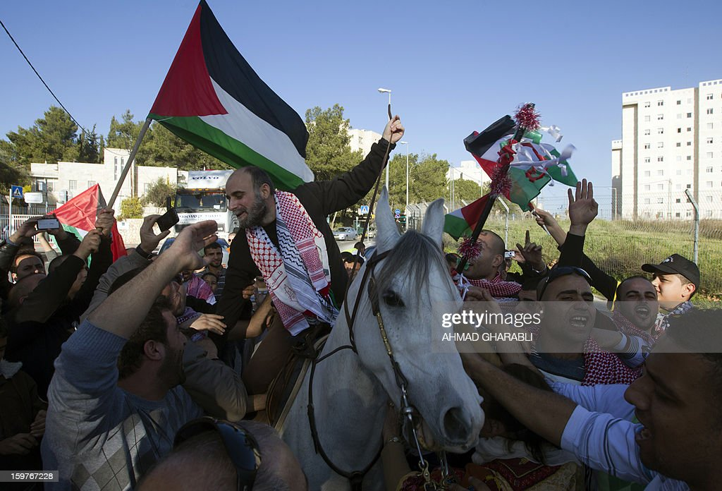 Former Palestinian prisoner Jihad Abedi rides on a horse through a neighborhood of Jerusalem following his release from an Israeli jail after serving 25 years, on January 20, 2013. AFP PHOTO/AHMAD GHARABLI