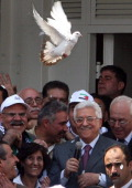 Former Palestinian prisoner Mohammed Ibrahim Abu Ali known as 'Abu Ali Yatta and Palestinian president Mahmud Abbas smile as white pigeons are...