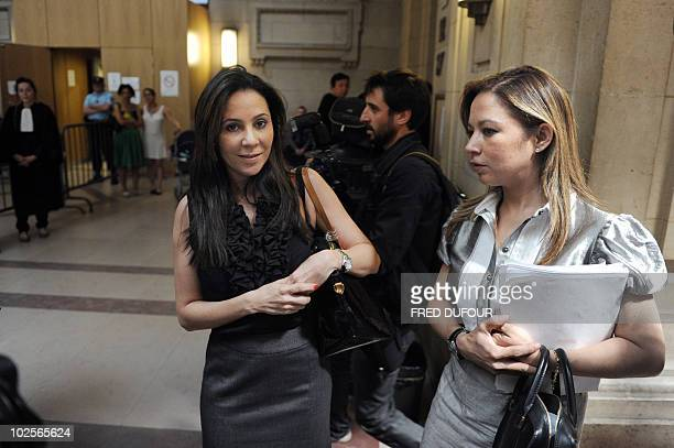 Former Panamanian dictator Manuel Noriega's daughters Sandra and Thais wait prior to attend the first day of their father's trial at the Paris...