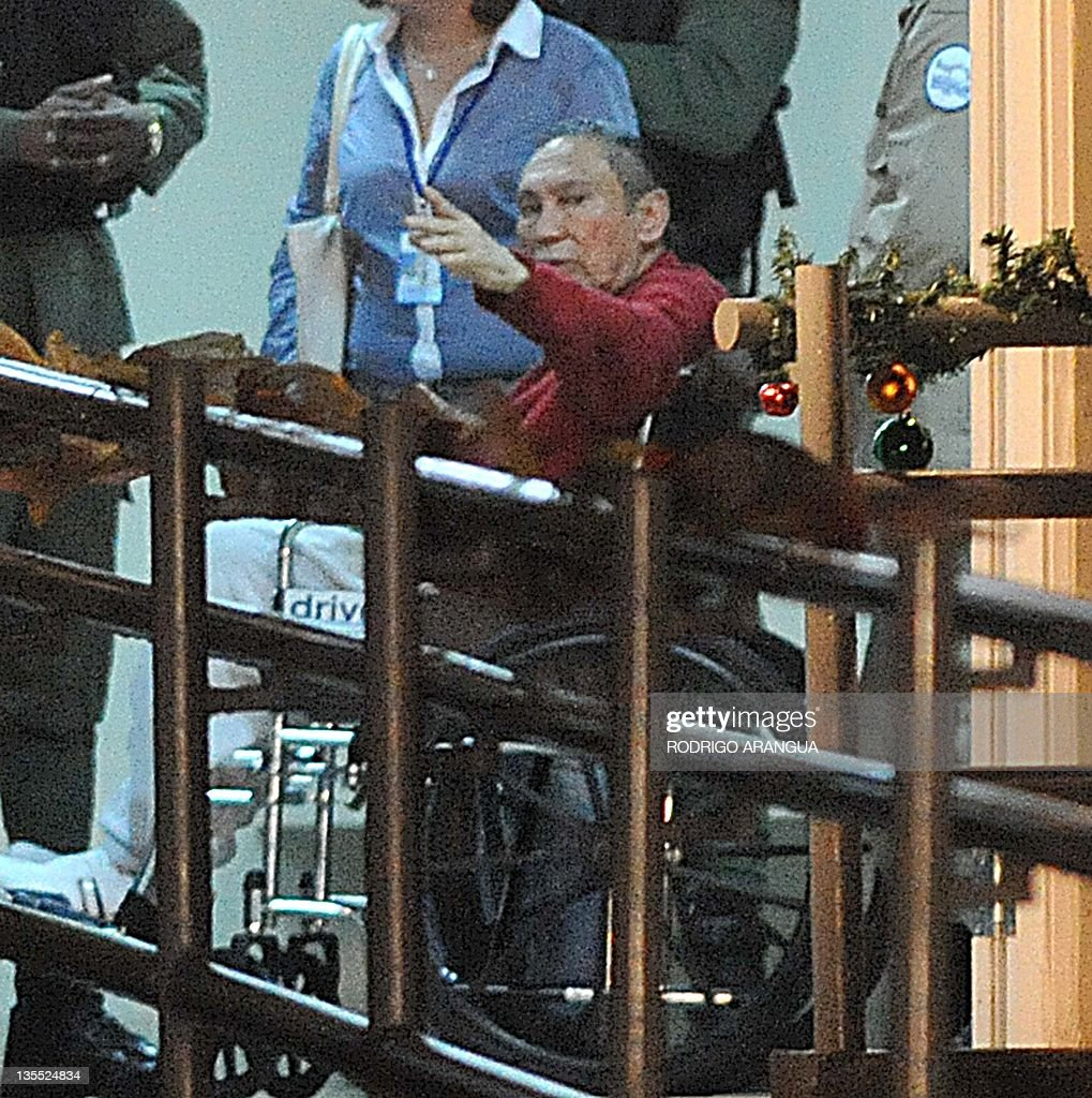 Former Panamenian dictator Manuel Noriega (red) after arrive at the Renacer prison, 25 km south east of Panama City, on December 11, 2011. Panamanian former dictator, Manuel Noriega,77, after more than two decades in prisons in the United States and France, returns home Sunday where he will continue to be incarcerated. AFP PHOTO/ Rodrigo ARANGUA