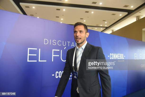 Former Paraguayan footballer Roque Santa Cruz arrives at the Conmebol headquarters in Luque Paraguay on May 17 2017 to participate in a meeting to...