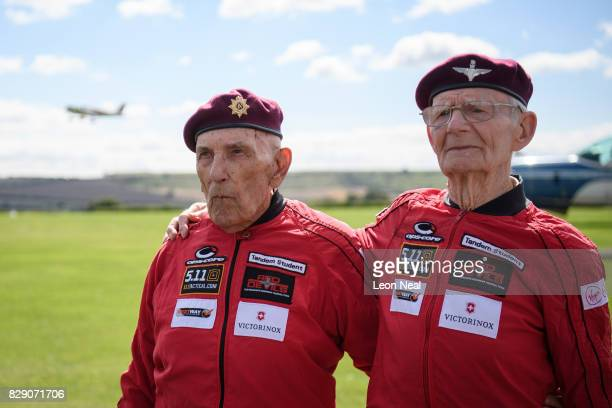 Former paratroopers Ted Pieri and Fred Glover pose for photographs ahead of their skydive at the Old Sarum airfield on August 10 2017 in Salisbury...