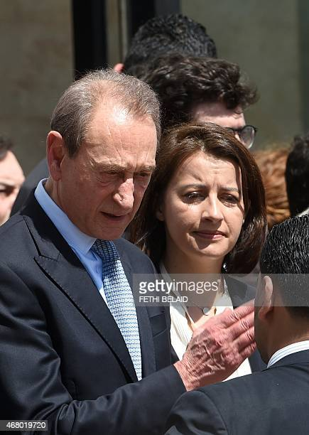 Former Paris mayor Bertrand Delanoe and EELV ecologist party member of parliament and former minister Cecile Duflot arrive to take part in an...