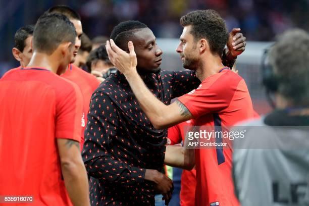Former Paris SaintGermain's French midfielder Blaise Matuidi embraces Paris SaintGermain's Italian midfielder Thiago Motta prior to the French L1...