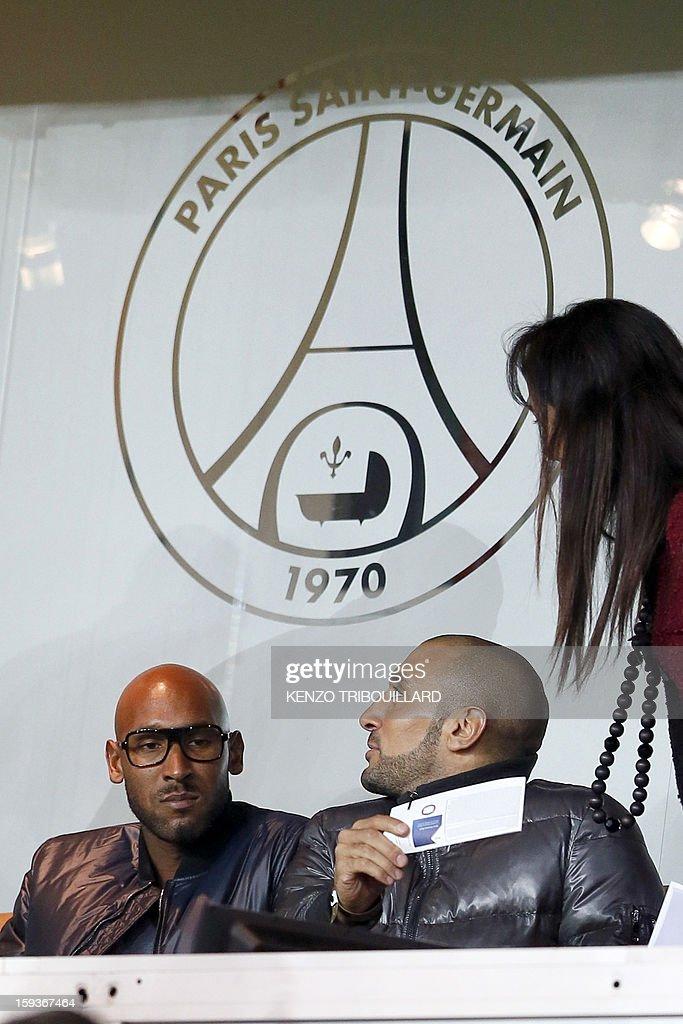 Former Paris Saint-Germain's French player Nicolas Anelka (L) attends the French L1 football match Paris Saint-Germain (PSG) vs Ajaccio (ACA) on January 11, 2013 at the Parc des Princes stadium, in Paris.