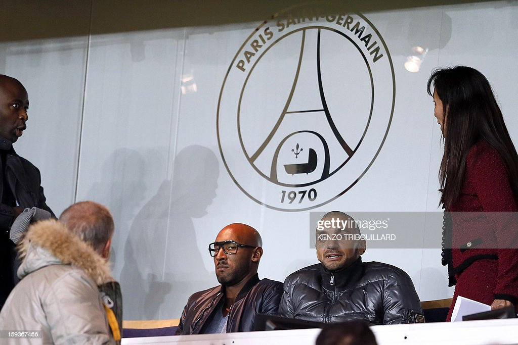 Former Paris Saint-Germain's French player Nicolas Anelka (C) attends the French L1 football match Paris Saint-Germain (PSG) vs Ajaccio (ACA) on January 11, 2013 at the Parc des Princes stadium, in Paris.