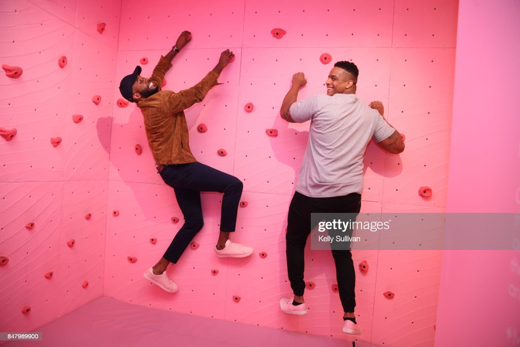 Former Patriots defensive lineman Corey Lewis (R) and Thomas Drew have fun at Museum of Ice Cream opening party on September 15, 2017 in San Francisco, California.