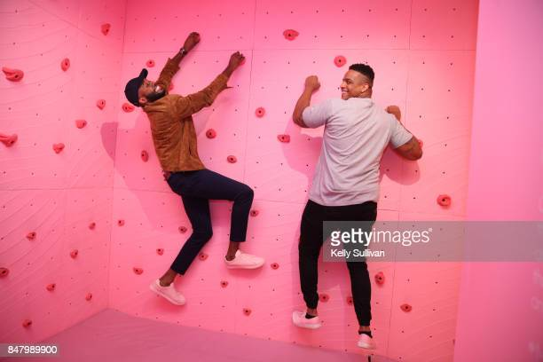 Former Patriots defensive lineman Corey Lewis and Thomas Drew have fun at Museum of Ice Cream opening party on September 15 2017 in San Francisco...