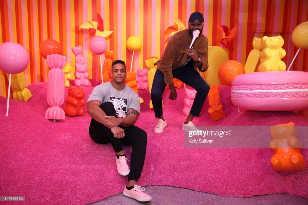 Former Patriots defensive lineman Corey Lewis (L) and Thomas Drew pose for a photo at Museum of Ice Cream opening party on September 15, 2017 in San Francisco, California.