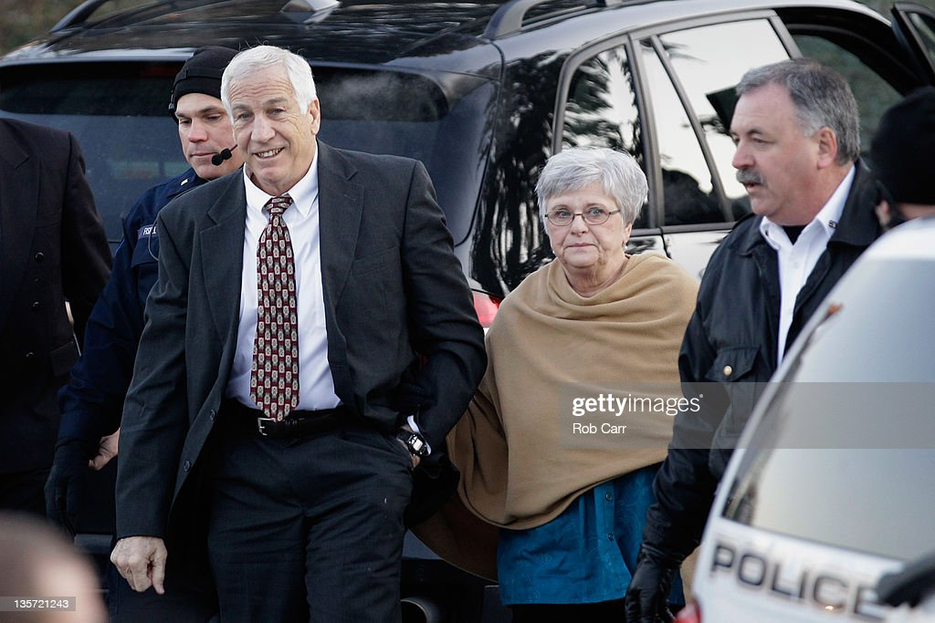 Former Penn State assistant football coach, <a gi-track='captionPersonalityLinkClicked' href=/galleries/search?phrase=Jerry+Sandusky&family=editorial&specificpeople=8608969 ng-click='$event.stopPropagation()'>Jerry Sandusky</a> and his wife Dottie arrive at the Centre County Courthouse on December 13, 2011 in Bellefonte, Pennsylvania. Sandusky who was charged with sexual abuse involving 10 boys he met through the Second Mile nonprofit organization will face his accusers during today's preliminary hearing.