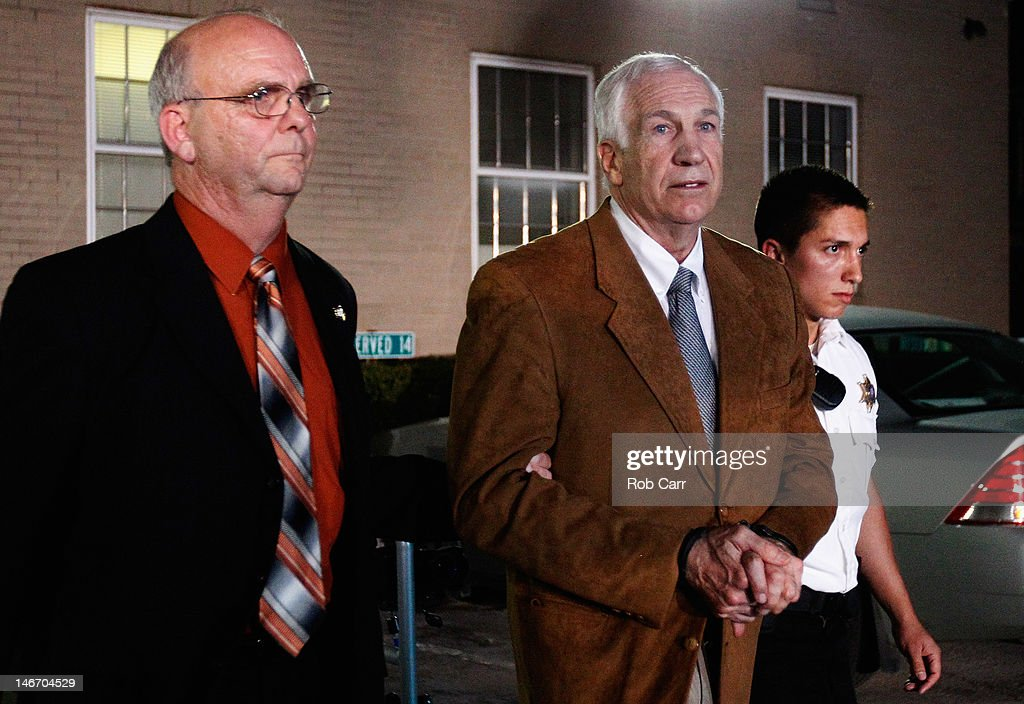 Former Penn State assistant football coach <a gi-track='captionPersonalityLinkClicked' href=/galleries/search?phrase=Jerry+Sandusky&family=editorial&specificpeople=8608969 ng-click='$event.stopPropagation()'>Jerry Sandusky</a> leaves the Centre County Courthouse in handcuffs after a jury found him guilty in his sex abuse trial on June 22, 2012 in Bellefonte, Pennsylvania. The jury found Sandusky guilty on 45 of 48 counts in the sexual abuse trial of the former Penn State assistant football coach, who was charged with sexual abuse of 10 boys over a 15-year period.