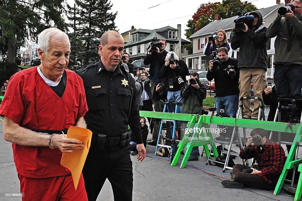 Former Penn State assistant football coach <a gi-track='captionPersonalityLinkClicked' href=/galleries/search?phrase=Jerry+Sandusky&family=editorial&specificpeople=8608969 ng-click='$event.stopPropagation()'>Jerry Sandusky</a> (L) walks into the Centre County Courthouse before being sentenced in his child sex abuse case on October 9, 2012 in Bellefonte, Pennsylvania. Sandusky faces more than 350 years in prison for his conviction in June on 45 counts of child sexual abuse, including while he was the defensive coordinator for the Penn State college football team.