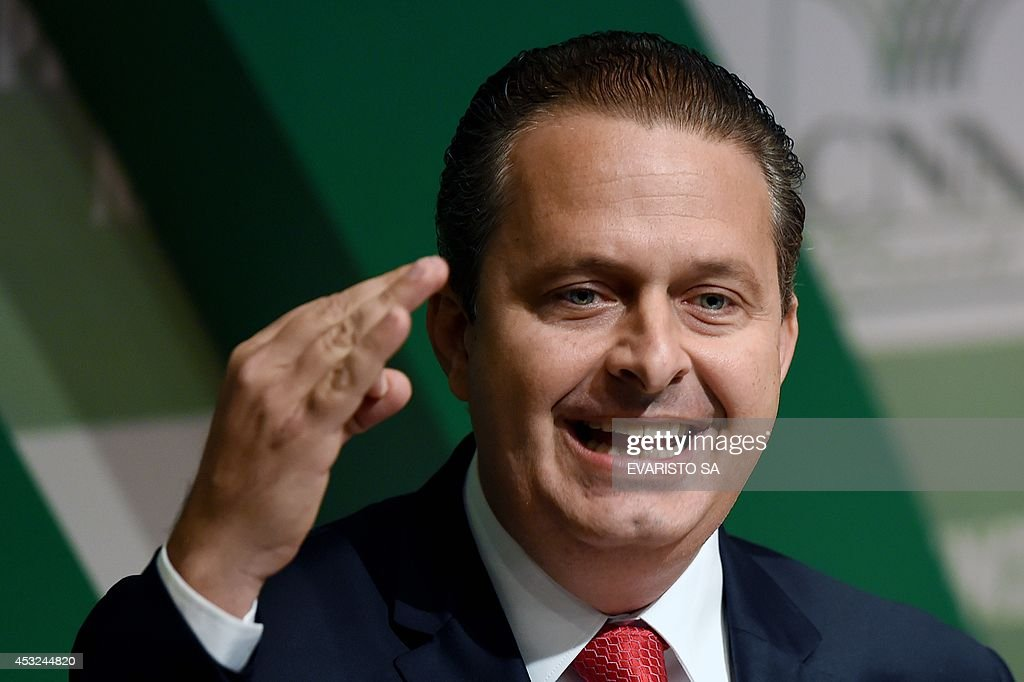 Former Pernambuco State governor <a gi-track='captionPersonalityLinkClicked' href=/galleries/search?phrase=Eduardo+Campos&family=editorial&specificpeople=2666081 ng-click='$event.stopPropagation()'>Eduardo Campos</a>, candidate of the Brazilian Socialist Party (PSB) for October's presidential election, speaks with businessmen at the National Agriculture Confederation headquarters in Brasilia, on August 6, 2014. Campos will face Brazil's President Dilma Rousseff, candidate of the Workers' Party (PT) and Senator Aecio Neves, candidate of the Brazilian Social Democratic Party (PSDB).