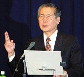 Former Peruvian president Alberto Fujimori gives a lecture at Tokyo's Takushoku University as a visiting professor 10 January 2002 Fujimori is on an...
