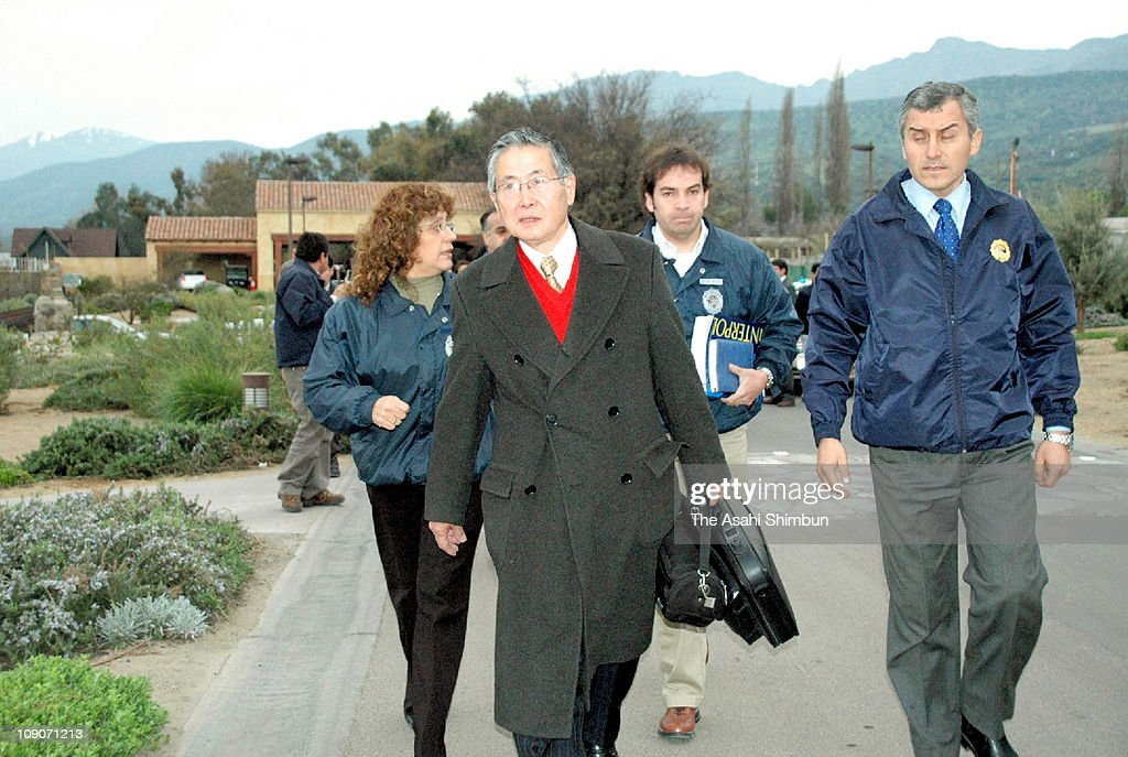 Former Peruvian President <a gi-track='captionPersonalityLinkClicked' href=/galleries/search?phrase=Alberto+Fujimori&family=editorial&specificpeople=206244 ng-click='$event.stopPropagation()'>Alberto Fujimori</a> leaves his house to be extradited to Peru on September 22, 2007 in Santiago, Chile.