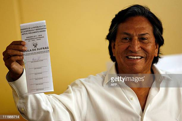 Former Peruvian President and presidential candidate for Alianza Peru Posible party Alejandro Toledo smiles before casting his vote during general...