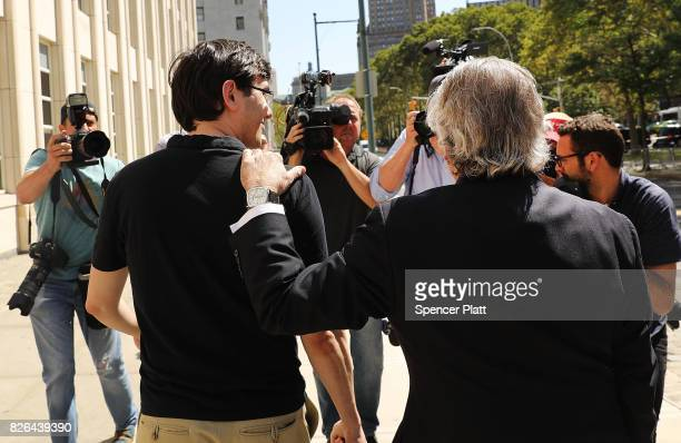Former pharmaceutical executive Martin Shkreli walks away from the US District Court for the Eastern District of New York with his attorney Benjamin...
