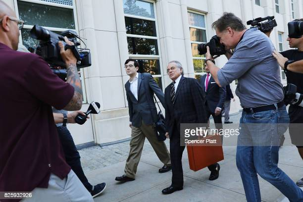 Former pharmaceutical executive Martin Shkreli walks with attorney Benjamin Brafman as they arrive at the US District Court for the Eastern District...