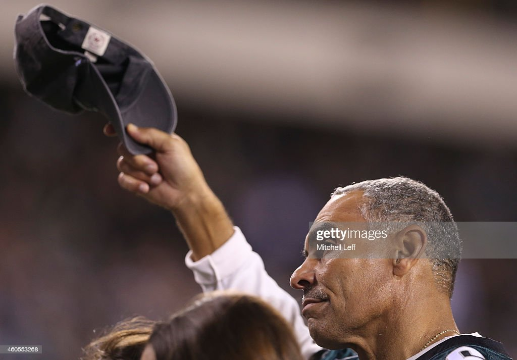 Former Philadelphia Eagles player Herman Edwards tips his cap to the crowd during a timeout in the game against the Dallas Cowboys at Lincoln...