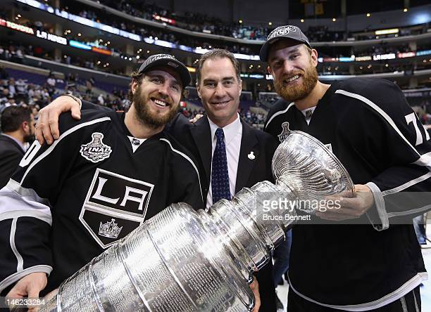 Former Philadelphia Flyers Mike Richards assistant coach John Stevens and Jeff Carter of the Los Angeles Kings hold up the Stanley Cup after the...