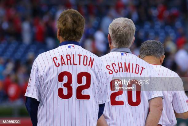 Former Philadelphia Phillies and Hall of Famers Steve Carlton and Mike Schmidt stand on the field during the Wall of Fame ceremony before a game...