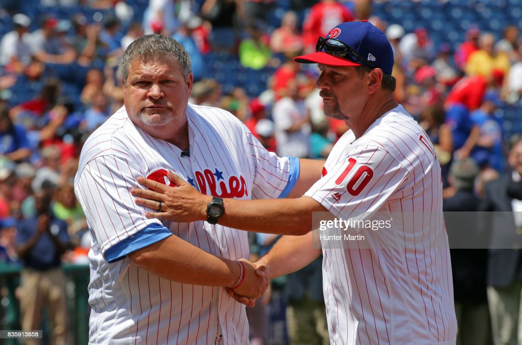 Former Philadelphia Phillies John Kruk (L) and Mickey Morandini participate in Alumni Weekend ceremonies before a game between the Philadelphia Phillies and the New York Mets at Citizens Bank Park on August 13, 2017 in Philadelphia, Pennsylvania. The Mets won 6-2.