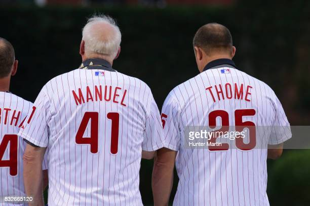 Former Philadelphia Phillies manager Charlie Manuel and Jim Thome stand on the field during the Wall of Fame ceremony before a game between the...