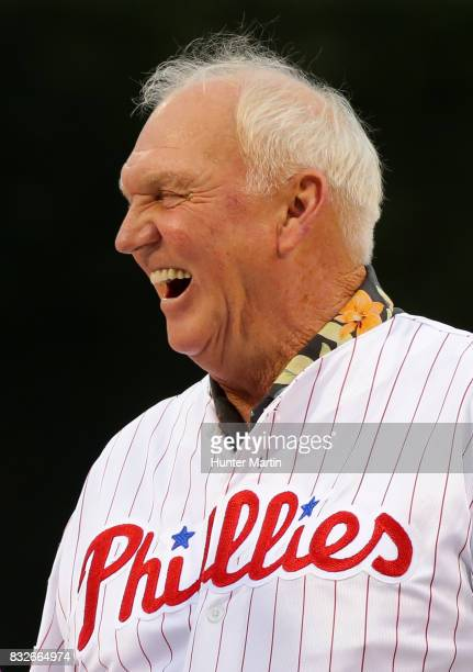 Former Philadelphia Phillies manager Charlie Manuel has a laugh as he stands on the field during the Wall of Fame ceremony before a game between the...